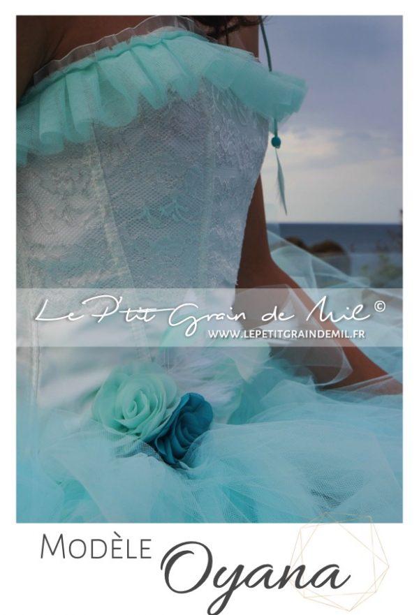 robe de mariée verte bustier plumes dentelle jupon tutu tulle traine amovible
